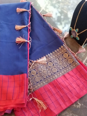 Blue soft silk plain saree with zari weaving and red checks border