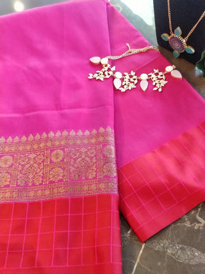 Pink soft silk plain  saree with zari and red checks border