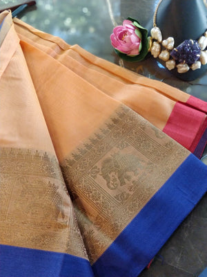 Yellow Chanderi saree with golden zari weaving and blue border