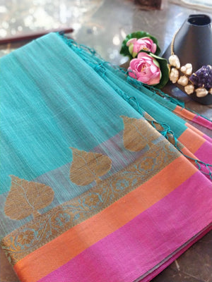Light green chanderi saree with pink and orange border and leaf motifs border