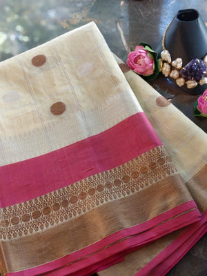 Cream check chanderi saree with with pink and golden zari weaving and golden booties allover