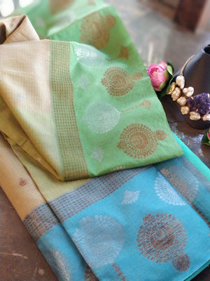 Light yellow chanderi saree with sky blue border with golden with silver motifs and golden and silver booties all over