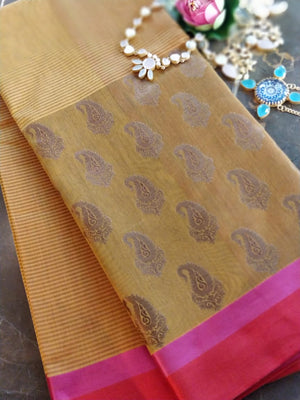Mustard Yellow Chanderi saree with zari paisely booties in skirt border pattern and in red pink combination solid border