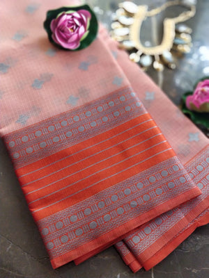 Light orange kota saree with silver zari weaving on orange border and silver booties all over