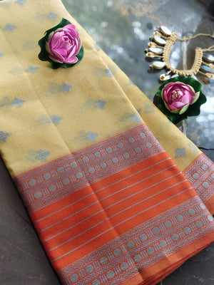 Light yellow kota saree with silver zari weaving on orange border and booties all over