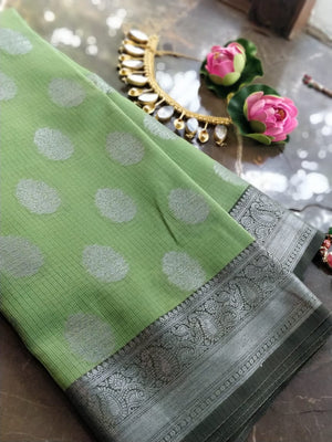 Green kota saree with silver zari weaving and booties all over