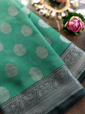 Dark sea green kota saree with silver zari weaving and booties all over