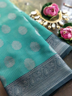Sea green Kota saree with silver zari weaving and booties all over