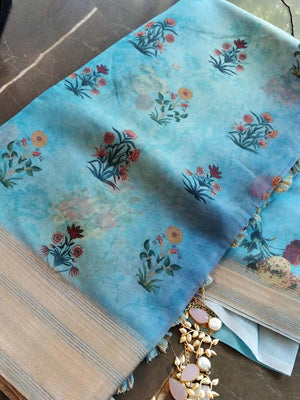 Blue floral print kora saree with golden zari border
