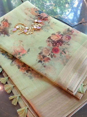 Light green floral print kora saree with golden zari border