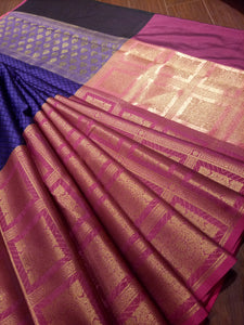 Horizontally divided purple and pink tanchoi kora saree with golden zari weaving