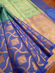 Horizontally divided in green and blue tanchoi kora saree with golden zari weaving