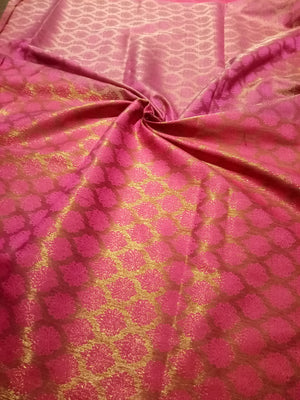 Horizontally divided in brown and pink tanchoi kora saree with golden zari weaving
