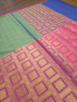 Horizontally divided in green and pink tanchoi kora saree with golden zari weaving