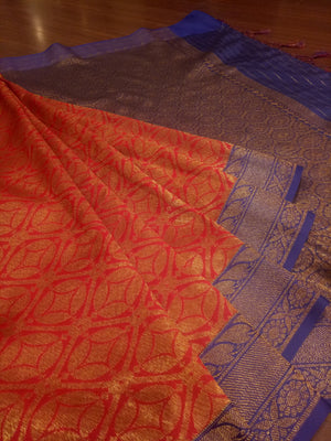 Red soft silk saree with golden zari weaving all over