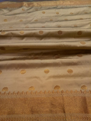 Beige soft silk saree with golden zari weaving and booties all over - EthnicRoom