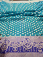 Blue khaddi Georgette saree with silver zari weaving and booties all over - EthnicRoom