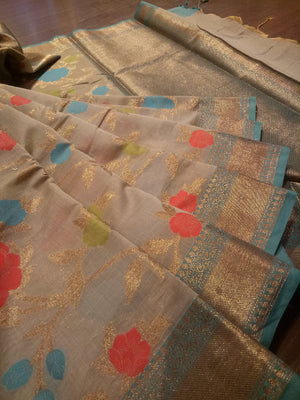 Greyish brown chanderi saree with golden with multicolor flowers jaal overall and golden zari weaving