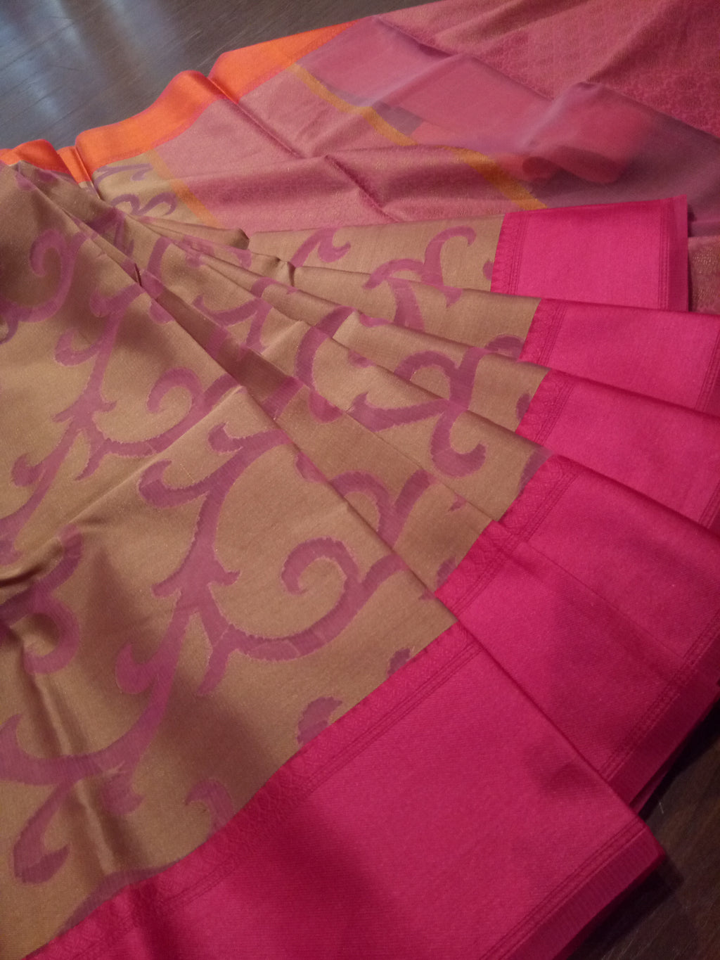 Brown kota saree with pink jaal overall and pink border
