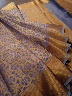 Blue supernet kota saree with golden weaving all over and golden zari border