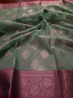 Light sea green kota saree with silver zari weaving on pink border and silver booties all over - EthnicRoom