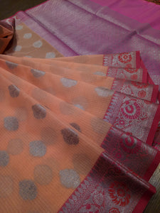 Light peach kota saree with silver zari weaving on pink border and silver booties all over