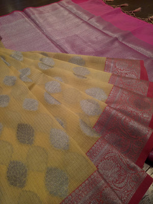 Light yellow kota saree with silver zari weaving on pink border and silver booties all over