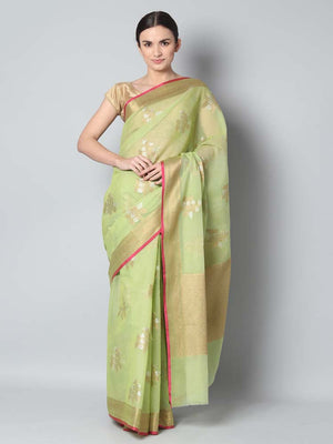 Light green kota saree with silver and gold flowers spread overall