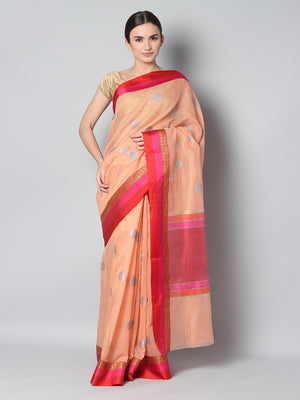 Light peach kota saree with silver zari booties and contrasting borders