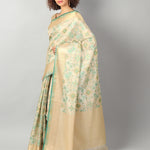 Zari kota with overall geometrical jaal and zari border and brocade blouse