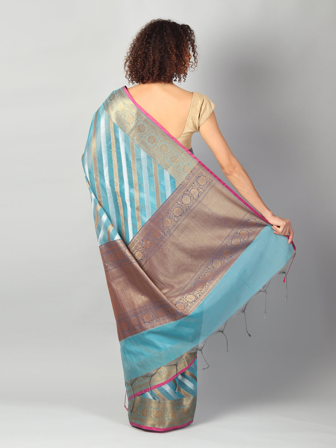 Kota saree with diagonal striped of blue & gold allover and zari border