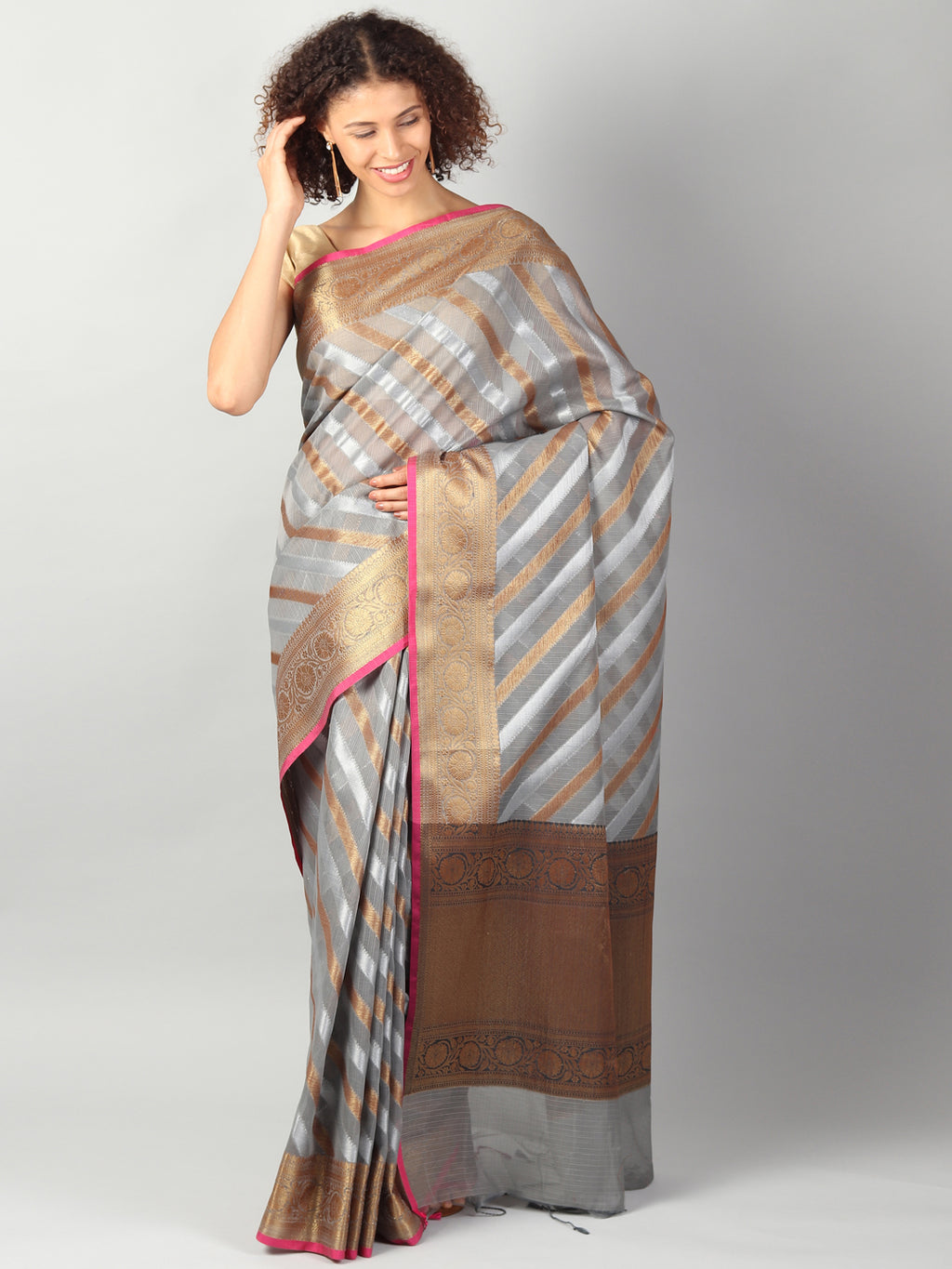 Kota saree with diagonal striped of gray & gold allover and zari border