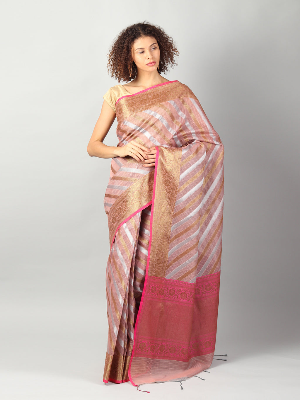 Kota saree with diagonal striped of onion pink & gold allover and zari border