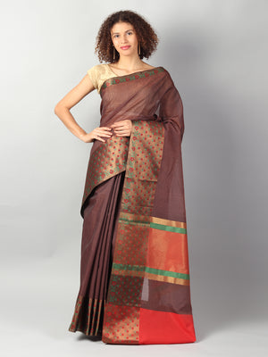 Brown kota with wide geometrical border & contrasting blouse