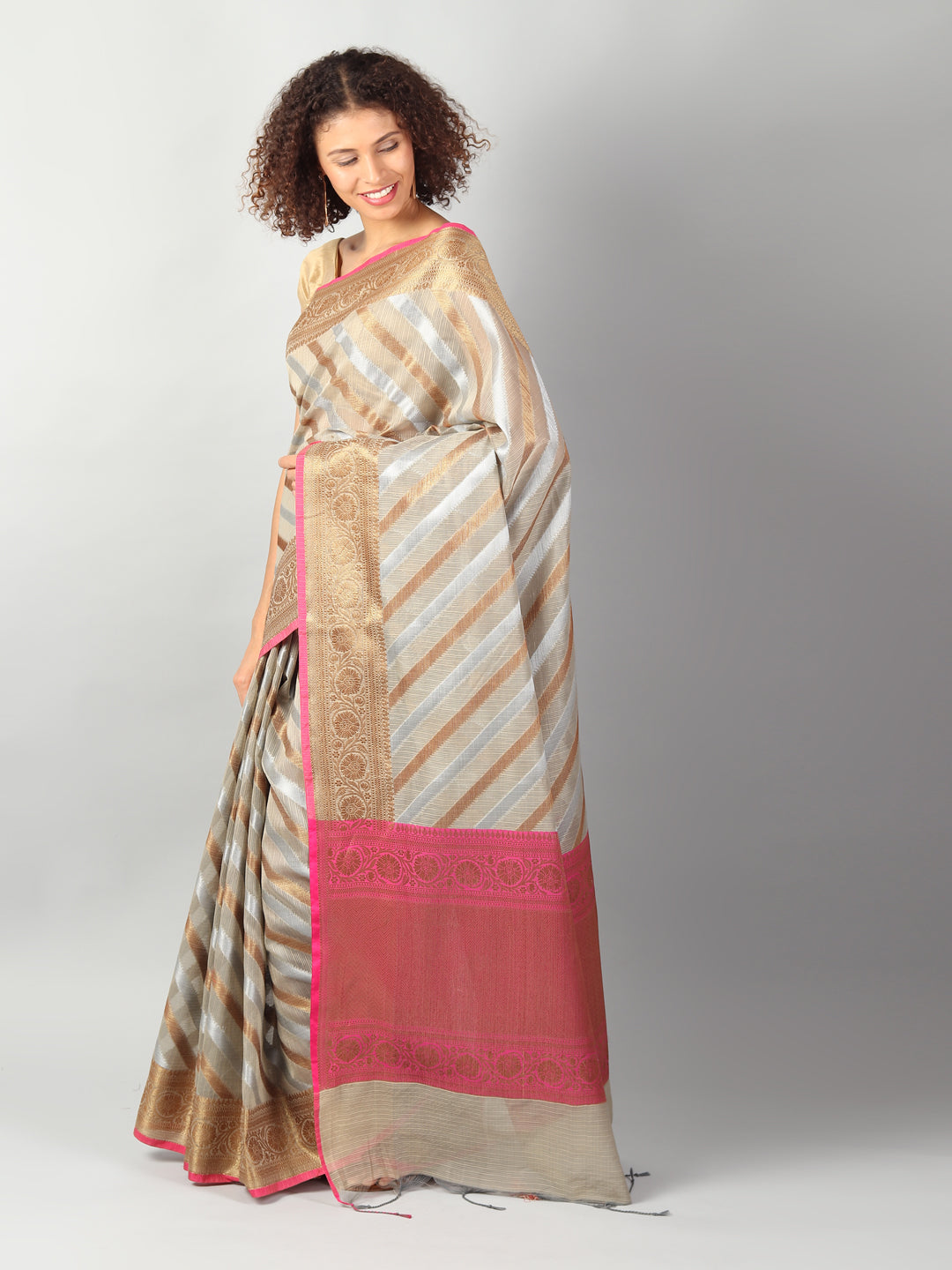 Kota saree with diagonal striped of beige & gold allover and zari border