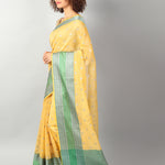 Yellow kota with big green and silver border and booties