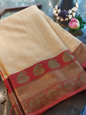 Yellow chanderi saree with golden zari weaving on red border