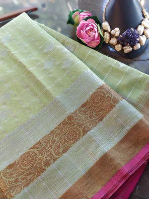 Mint green check chanderi saree with golden and silver zari weaving and golden and silver booties all over