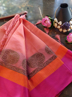 Peach chanderi saree with orange and pink border and golden motifs
