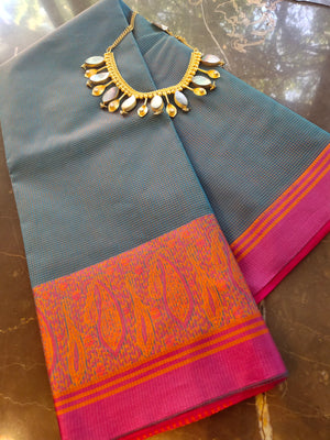 Blue supernet saree with allover small checks and pink resham border