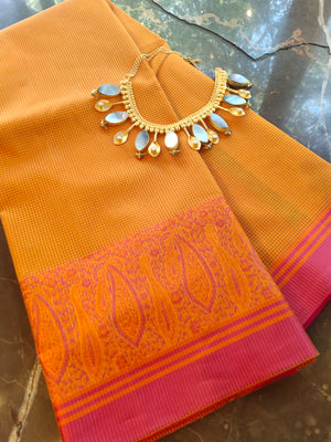 Orange cotton supernet saree with resham border