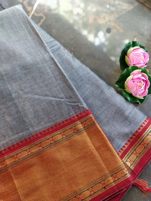 Grey south cotton narayanpet saree with orange zari border