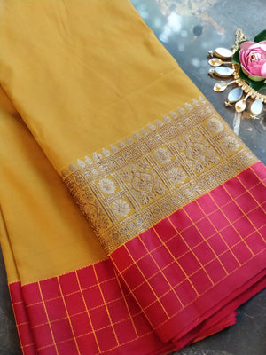 Mustard yellow soft silk with red and zari border