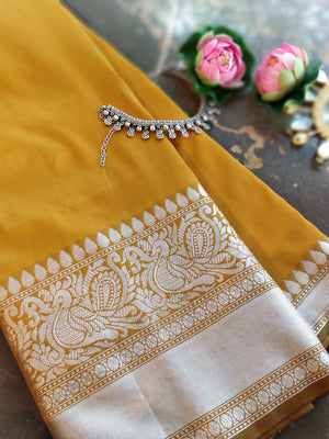 Mustard yellow soft silk with silver zari border