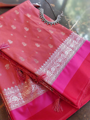 Peach soft silk saree with silver booties and red pink border