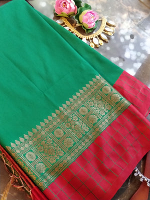 Bottle green soft silk saree with antique gold and red border