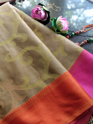 Light brown kota saree with yellow jaal overall and pink border
