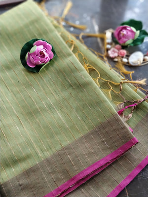 Green zari linen saree with all over self stripes and pink border