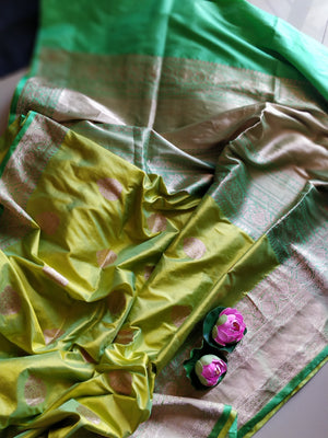 Pure katan silk saree in fresh green with zari border and booties