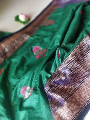 Green pure silk saree with golden zari weaving and flower booties all over